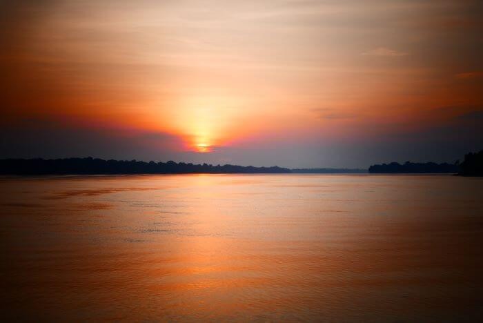 Sunset over the Rio Negro river, at Anavilhanas lodge in the Brazilian Amazon jungle