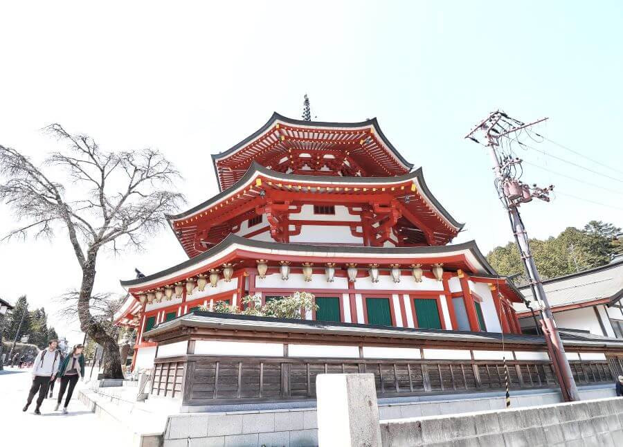 Red pagoda temple in Koyasan village, Japan