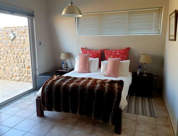 Bedroom accommodation at Naankuse Lodge in Namibia
