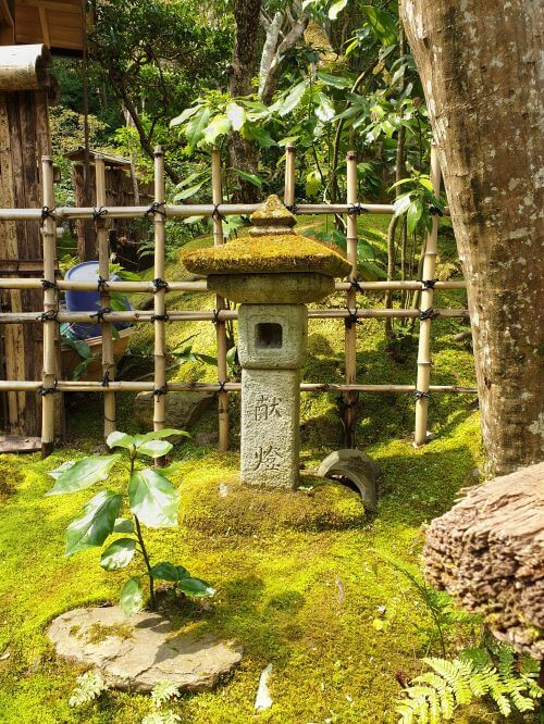 A moss covered Buddhist lantern at Gioji temple in Japan