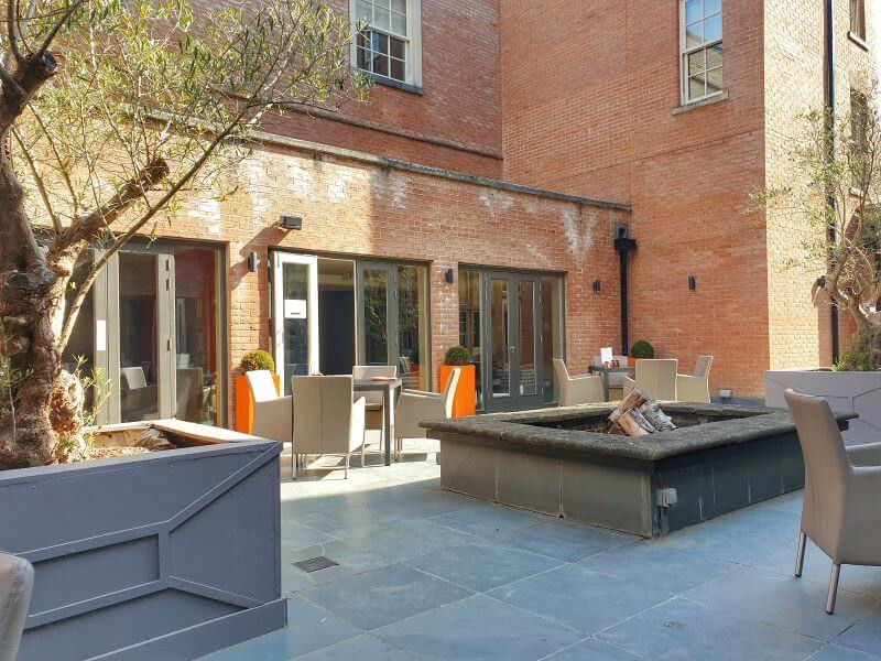 Outdoor seating at Reflections restaurant at Alexander House Hotel in West Sussex