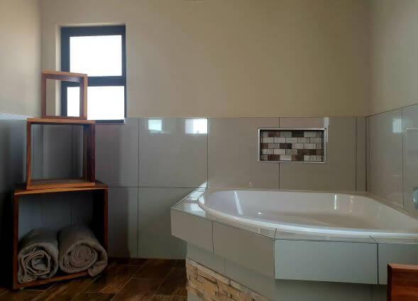 Bath in en suite bathroom, Sossusvlei Lodge