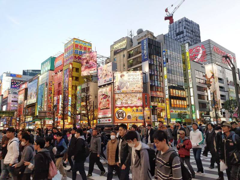 Shibuya crossing filled with pedestrians, in Tokyo