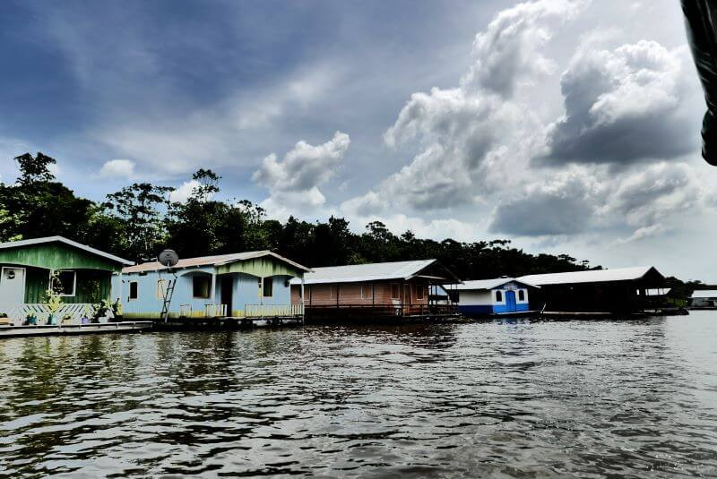 Boat trip to visit a floating village near Manaus in Brazil