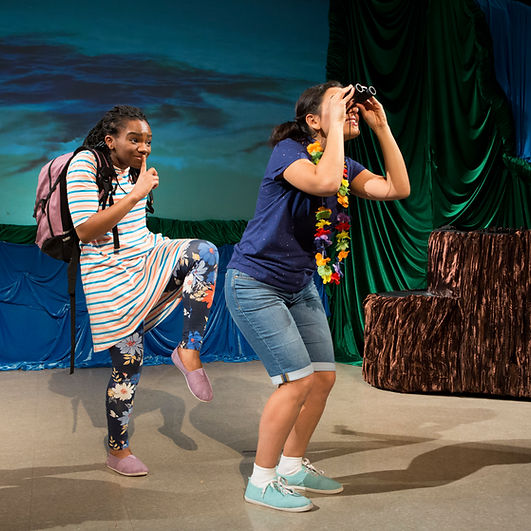"""Actors Bria McLaughlin (as Violet) and Michaela Di Cesare (as Sarah) perform in """"Birds of a Feather"""". Violet sneaks up on an unspecting Sarah, who is looking through binoculars."""