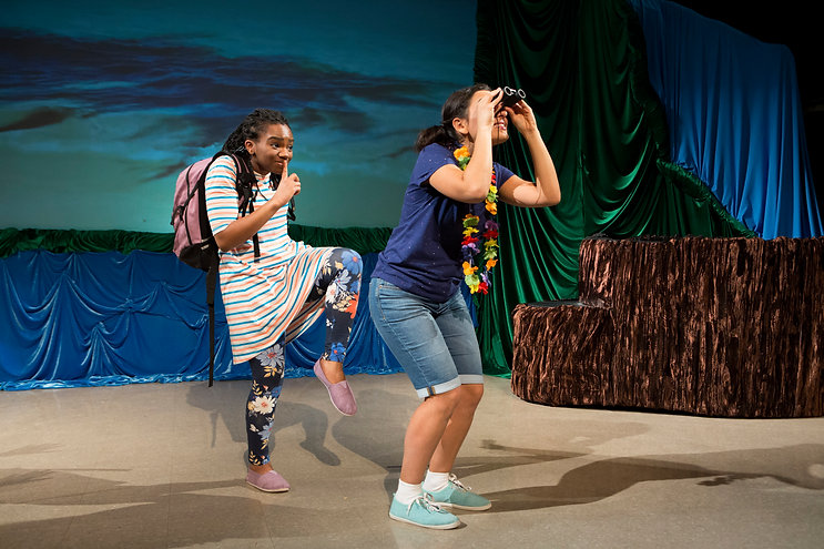 Birds of a Feather by Robert Watson. Actors Bria McLaughlin and Michaela Di Cesare are mid performance, looking through binoculars.