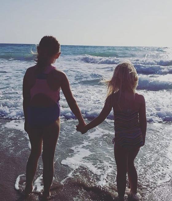 Kids watching ocean