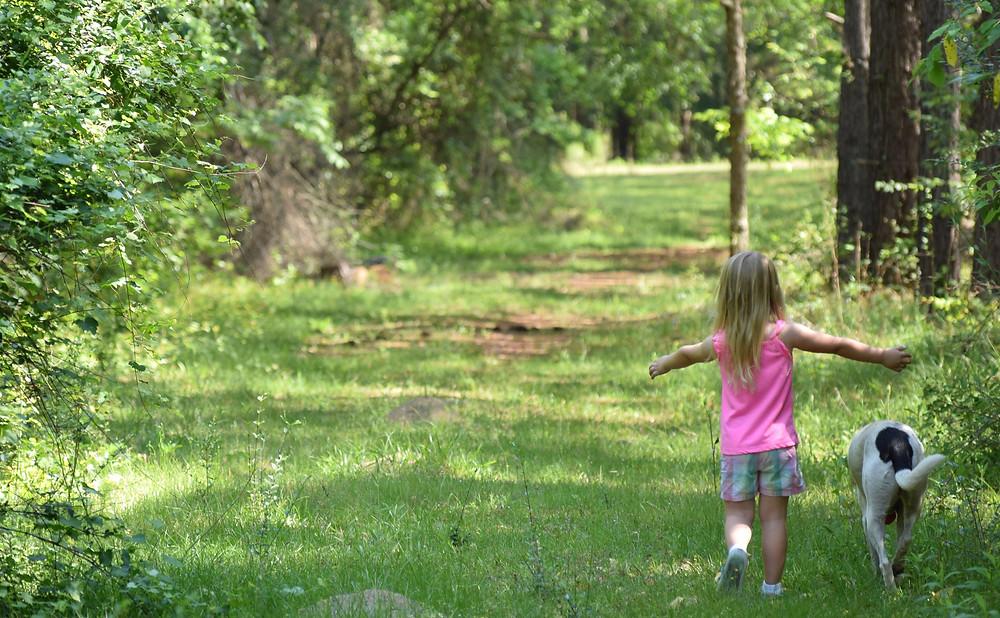 Girl walks path