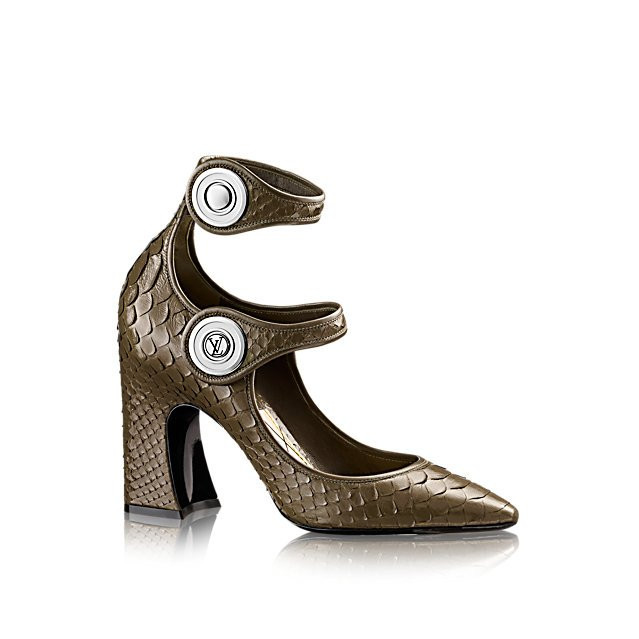 One of the statements of Louis Vuitton's 2015 Cruise collection, this striking pump in luxurious python skin is characterized by its double ankle strap, outsize LV-engraved snap fasteners, and high, chunky heel.