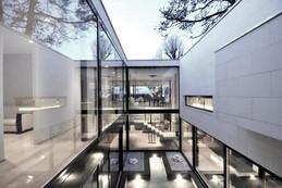 Modern glass house overlooking lake Geneva
