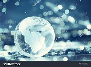 stock-photo-glass-crystal-globe-on-lapto
