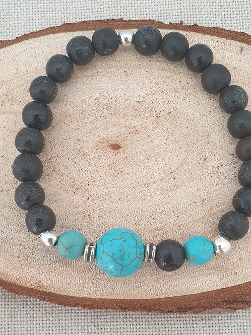Bracelet homme extensible noir et turquoise.