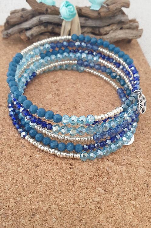 Bracelet en fil mémoire couleur bleu foncé et argent.