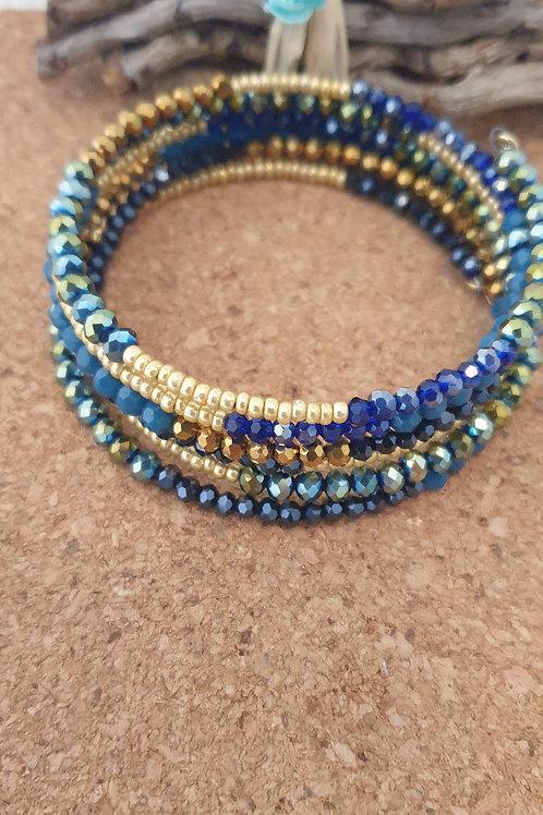 Bracelet en fil mémoire couleur bleu et or.