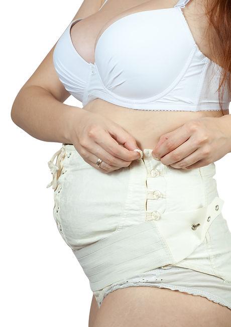 bigstock-Pregnant-Woman-Dressing-Matern-9026161.jpg