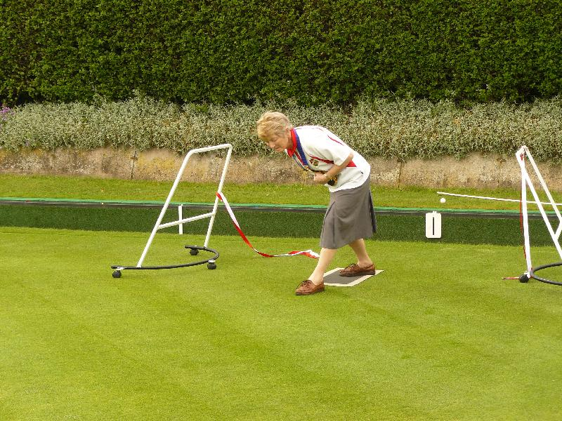 Joy delivering first bowl to open the green.jpg
