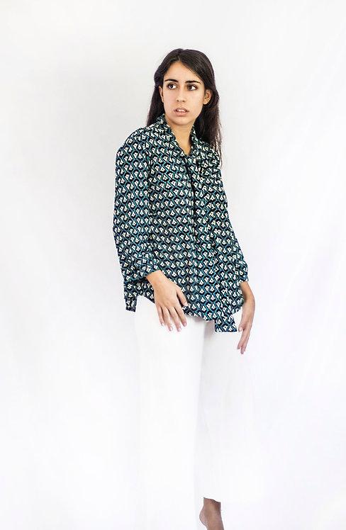 Blusa turquesa con estampado