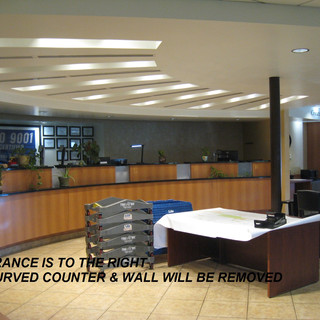 The building was formerly a credit union, so this bank of tellers' desks will be removed.