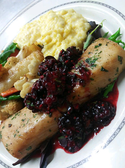 Herbed Mahi mahi with tarragon basil blackberry sauce served with creamy polenta and chef veggies