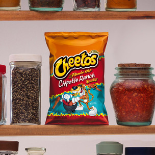 """I would say """"get 'em while they're hot', but this spicy sensation is here to stay. Introducing Flamin' Hot Chipotle Ranch Cheetos."""