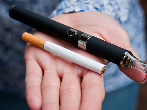 closeup hand of woman with e-cigarette_.
