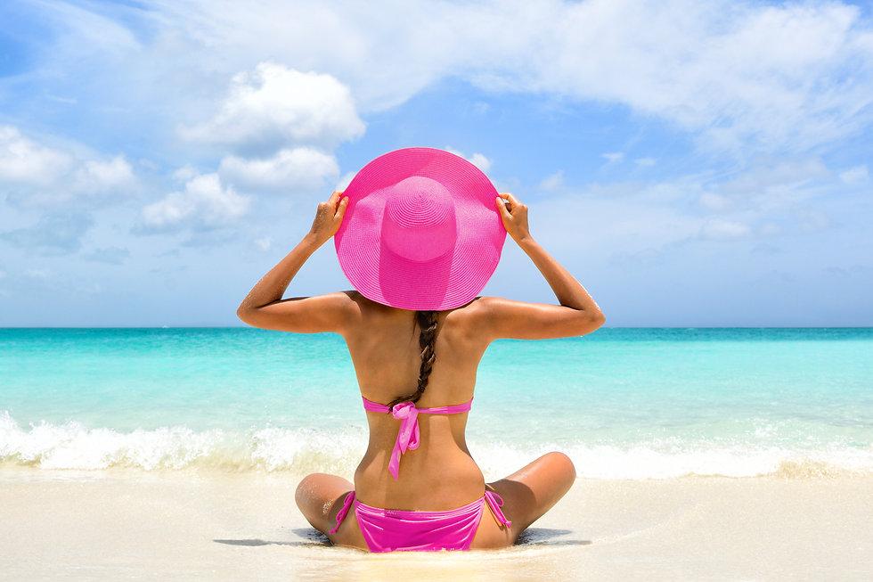Cute pink bikini beachwear woman relaxin