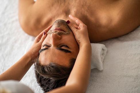Male beauty - man receiving facial massa