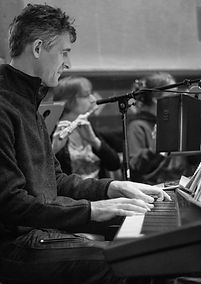 Carey at piano b&w.jpg