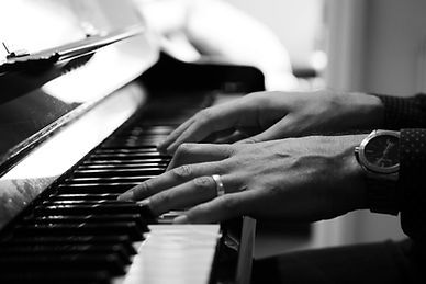 hands on piano b&w.jpg
