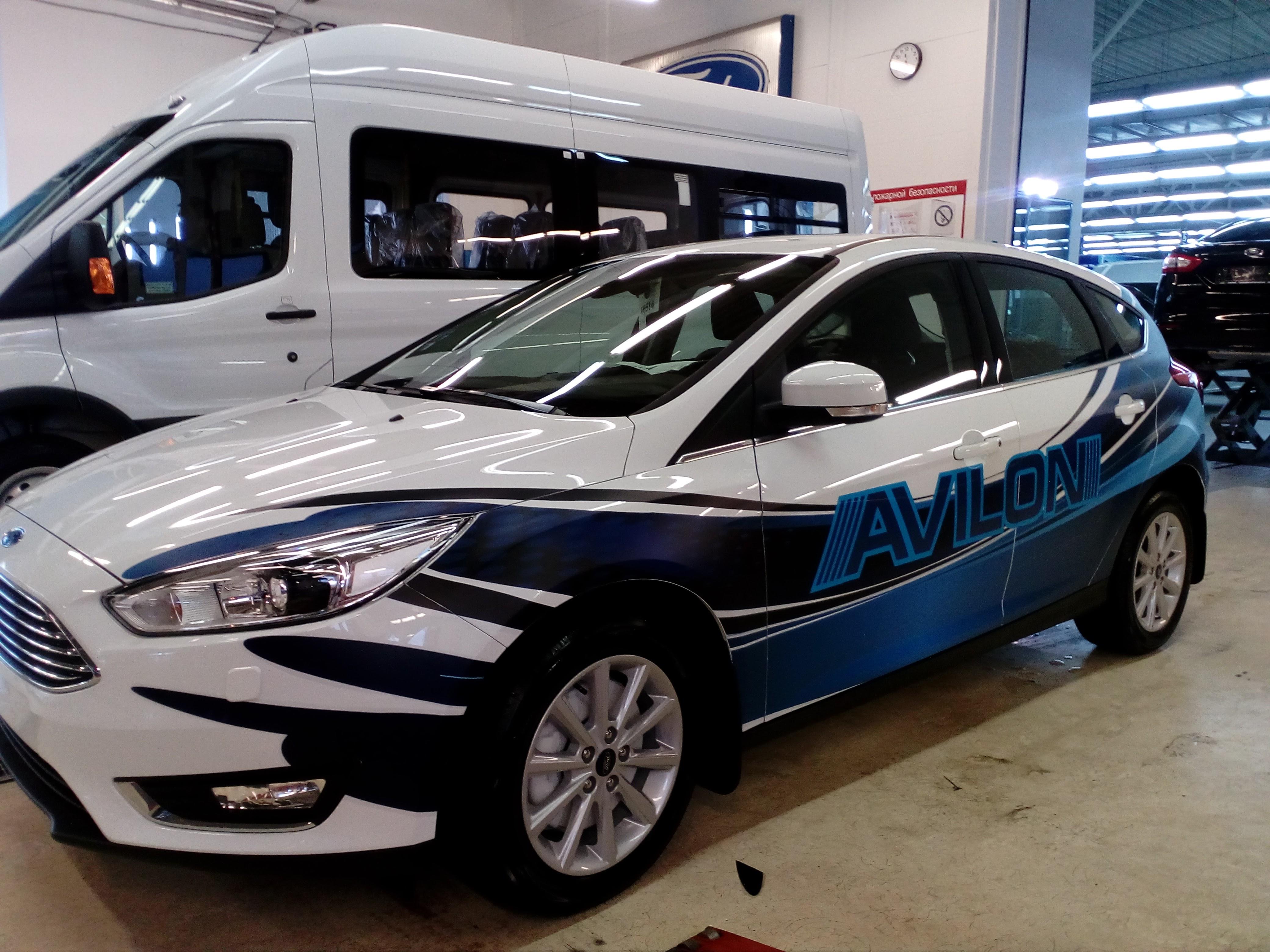 Рекламная оклейка автомобиля Ford Focus