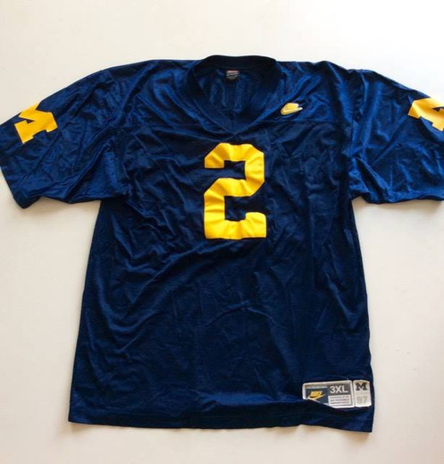 hot sale online c24e2 7ffe1 Vintage Michigan Wolverines Charles Woodson Jersey by Nike