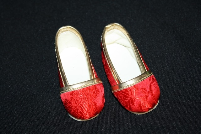 Red brocade slip on shoe with shiny
