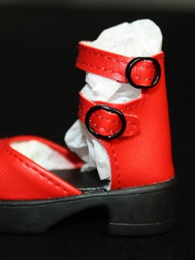 Red shoes with double buckle