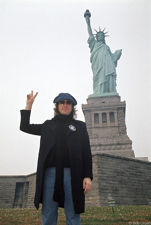 John Lennon in front of The Statue of Liberty (color). New York City, 1974