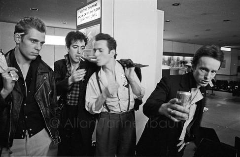 The Clash arrive at JFK - Paul Simenon, Mick Jones, Joe Strummer, Topper Headon.