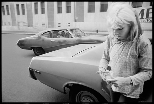 Debbie Harry with car. NYC, date unknown