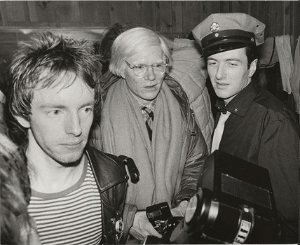 (L-R) Topper Headon of The Clash, Andy Warhol and Joe Strummer / The Clash Palladium, NYC 1979