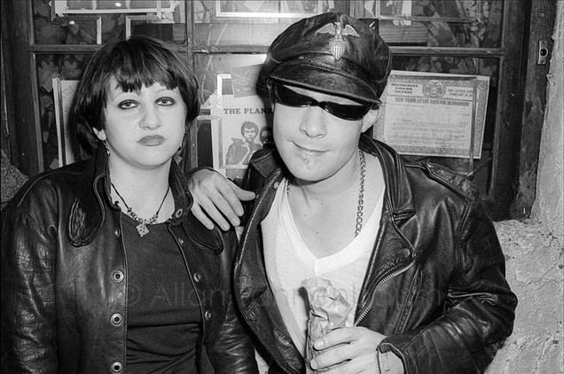 A punk couple hanging out in front of CBGB.