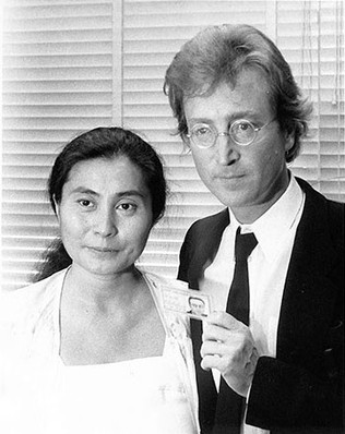 John Lennon & Yoko Ono with green card NYC 1976