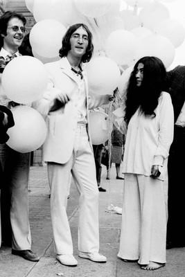 Robert Fraser, John Lennon and Yoko Ono.