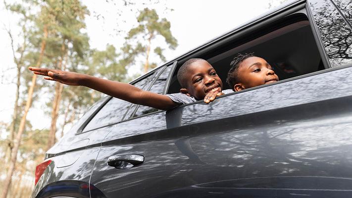 kids-looking-outside-though-their-car-window.jpg