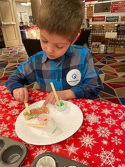 Noah decorating cookie.jpg