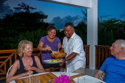Alfred & Dianie serve guests