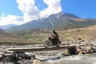 Ride across the old bridge.JPG
