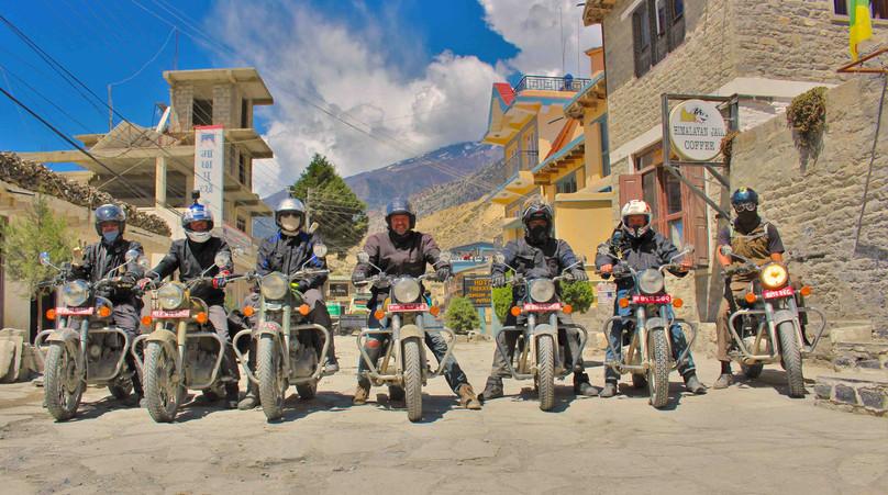 Riders under sun of Mustang.JPG