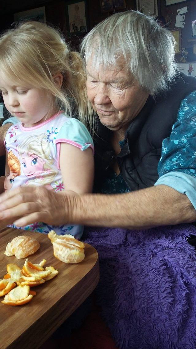Bonnie helping her granddaughter, photo by Courtney McMahan