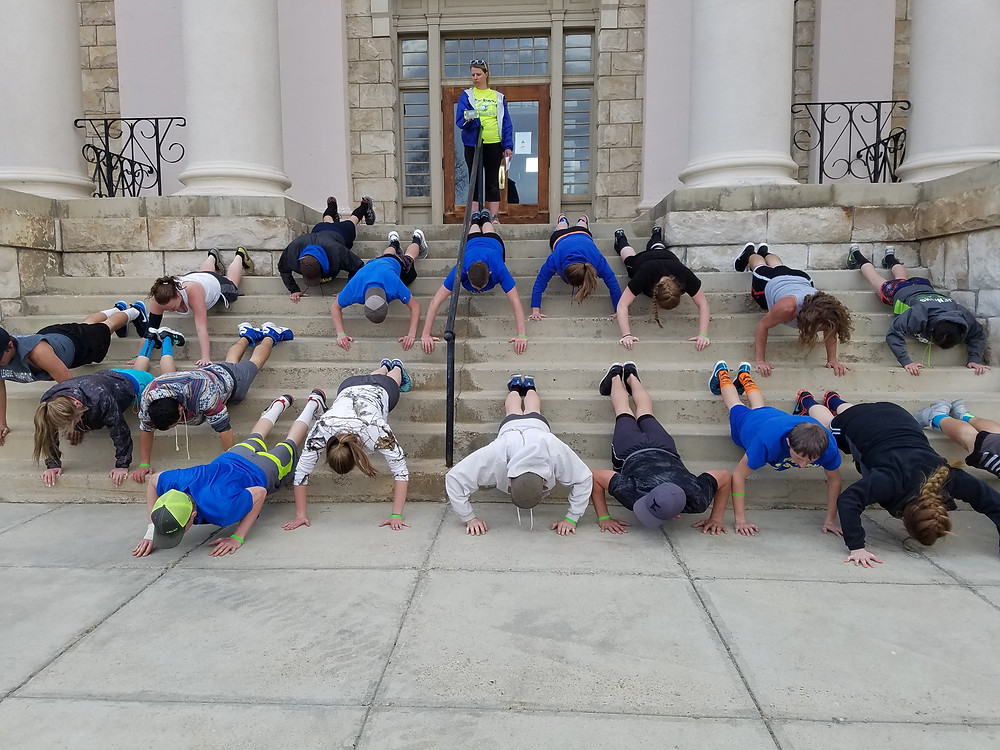 Track team working out on County Courthouse Steps