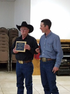 Buck Houston receiving a Special Award from Wade Allnutt at the North Park Stockgrowers Banquet