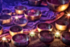 singing bowls lit by candlelight.jpg