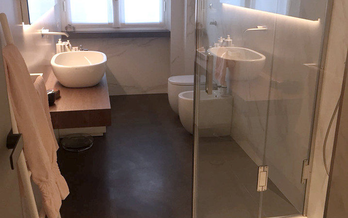 Pavimento in piastrelle in gres a grandi lastre, interior design, Pavimenti Pavia, piastrelle Pavia, arredo bagno Pavia, parquet Pavia